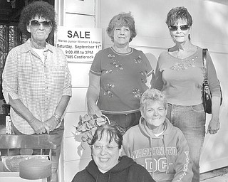 """GFWC/Warren Junior Women's League International Outreach Community Service and Conservation Community Service programs sponsored a garage sale in September. Proceeds from the event will provide much-needed food, shelter and educational materials for mothers and orphaned or abandoned children in war-torn countries. Among those reaching out to help the helpless through the """"Mother's Without Borders"""" program are, from left in back, Shelby McElravy, district chairman of International; Peggy Boyd, event chairwoman; and Dorie Harris, co-chairwoman; and in front, Barbara Denman and Lee Carter, Conservation."""