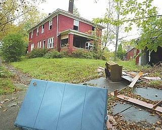 With remnants of furniture littering the pavement, a Trenton Avenue house sits vacant just two blocks from the residence of Thomas J. Repchic. Repchic was fatally wounded Saturday afternoon in a drive-by shooting nearby. His wife, Jacqueline, was shot in the leg and survived.