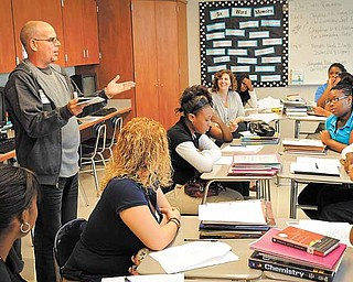 Cuban poet Raul Hernandez Ortega works with student in Jennifer Walker's AP Lit/Comp class at Youngstown's East High School on Wednesday.