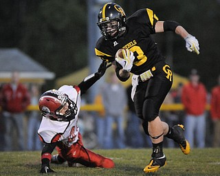 Crestview's Adam Coppock breaks the tackle of Columbiana's Britton Steiginga during their game at Crestview on Friday night. Photo/Mark Stahl