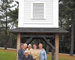 Members of the Harding Park Meeting House Building Committee stand in front of the bell tower salvaged from the historic First Presbyterian Church. They are,Joe Jendrasiak, front, and back from left, Mary Buchenic, Sue Lambert, Judy Ruby, Linda Clark and JoAnn Cutter. The committee plans to reassemble the church that was dismantled in the 1990s and make it a multipurpose center in Harding Park in Hubbard.