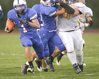 ROBERT K. YOSAY   THE VINDICATOR..Blue Devils #1  Ryley Sheptock  takes off for pay dirt for a 50+ yard touch down run in the first quarter - behind him is #2 Donnie Bolton giving the INdians #65  Levi Haddox  a key block for the TD RUN - Western Reserve Blue Devils  vs Southern Local Indians at Western Reserve Stadium ..-30-..