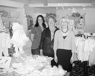 Prepared to select clothing to be featured at the YBPW Champagne Luncheon and Fashion Show on Oct. 9 at Antone's Banquet Center in Boardman are, from left, Melissa Lias, president of YBPW; Anne McMahon, former club president; and Sandra Barger, fashion show chairwoman.