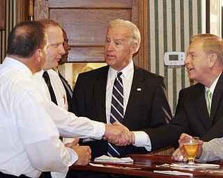 William D LEwis The Vindicator  Ohio Gov Ted Strickland shakes hands with John Naples, one of the owners of the Golden Dawn during a visit Monday by  VPJoe Biden (center) to Youngstown. at far left is Benny Naples, another owner.