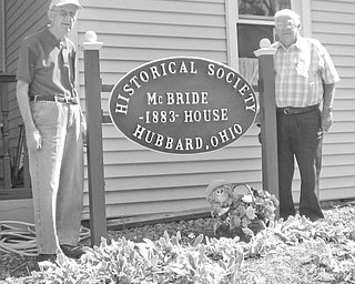 Visitors will no longer have to wonder when the McBride House, at 27 Hager St., Hubbard, was built. Those attending the next open house from 2 to 5 p.m. Oct. 10 have only to look at the newly refurbished sign displayed by, Ralph Cooper, left, and Fred Thomas, members of the Hubbard Historical Society, to learn the house was built in 1883. Tours of the historical house are regularly scheduled for the second Sunday of each month. For information on scheduling other tours, contact Cecilia Cooper at 330-534-4247.