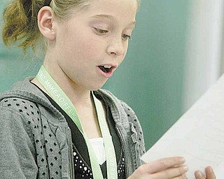 Kayla Sahli reads a part during her audition. She is one of more than 90 Frank Ohl fifth-graders participating in the new drama club this year.