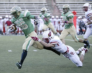 William D Lewis The Vindicator  Usulines Akise Teague eludes St Charles #6 during first qtr action Friday.