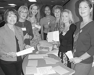 """Prepared to mail information about the """"It's a Wonderful Life ... In The Mahoning Valley"""" fundraiser to be sponsored by the Junior League of Youngstown on Oct. 21 at the Holiday Inn in Boardman are committee members, from left, Joan Gallito; Barbara Banks; Amy Banks; Kera Thompson; Cathy Campana; Liz Skeels, chairwoman; and Marion Dunham."""