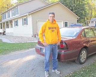 Todd Hanks stands outside his South Leavitt Road home near the spot where he discovered items from his garage and another home Sept. 25.  He suspects that thieves left the items on the edge of the driveway so they could pick them up later. His was one of many break-ins in Trumbull County in recent weeks..