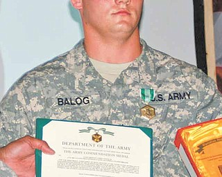 Balog receives his award for first place in the United States Division-South Noncommissioned Officer of the Quarter competition..