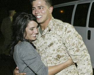 William D. Lewis|The Vindicator Marine reserve cpl. Nick Marchese of Niles embraces his girlfriend Kelsy Mikesell  upon arriving at the Youngstown Airbase  from Afghanistan Thursday night.