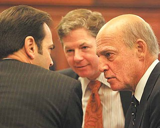 George A. Stamboulidis, left, back to camera, lawyer for Anthony M. Cafaro Sr.; John F. McCaffrey, center, lawyer for the Ohio Valley Mall Co. and the Marion Plaza Inc.; and Martin G. Weinberg, another Cafaro lawyer, huddle at the Thursday hearing in Mahoning County Common Pleas Court.  Visiting Judge Wolff  summoned grand jurors to the courthouse, where he admonished them to keep their oath of secrecy to avoid breaches.