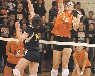 Mineral Ridge's Meghan Garland (15) prepares to return a ball sent over the net by United' Rachel Sell (14) during Thursday's game at Mineral Ridge High School.