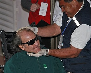A paramedic embraces rescued miner Franklin Lobos, left, 53, as he arrives to the hospital of Copiapo, Chile, Wednesday, Oct. 13, 2010. Lobos is the twenty-seventh of 33 miners rescued from the San Jose mine after more than 2 months trapped underground. (AP Photo/Dario Lopez-Mills)