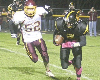 FOOTBALL - (7) Brian Orr tries to get away from (52) Robbie Grahovac Friday night at Crestview. - Special to The Vindicator/Nick Mays