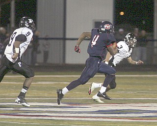 ROBERT K. YOSAY | THE VINDICATOR..#4 Fitch  Larry Vines takes off for a TR on the kickoff starting the second half -   he is beating #3.... Marcus Peffer and #9  McKinley Lancaster ........Austintown Fitch hosted Massilon Perry Panthers  at Fitch Stadium...  --30-..