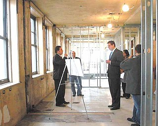 Dominic Gatta III, left, shows U.S. Rep. Tim Ryan of Niles D-17th, plans for apartments on the second floor of the Federal Building. The Gatta Co. of Niles is in the process of renovating the Youngstown landmark..