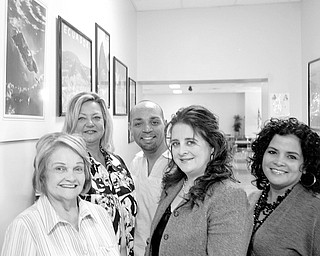 William D Lewis | The Vindicator: OCCHA committee members are, from left, Mary Isa Garayua, OCCHA executive director; Liz McGarry, OCCHA board member; Benito Velazquez Jr., OCCHA board president; Atty. Miriam Ocasio, OCCHA vice president and chairwoman of the gala, and Sara Cuevas, co-chairwoman of the gala.