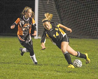 (14) Anna Hardenbrook of Crestview tries to keep the ball from (10) Alyssa Casto during their game Monday night in New Middletown.