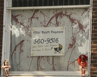 ROBERT K. YOSAY | THE VINDICATOR..After Death Day Care halloween display -  606 Niles Road, Niles--Spray painted baby dolls hanging from trees, cribs etc. very gory and offensive, a resident says.  City hall cannot do anything about it.  Homeowner spoke to Cohen on Monday.....  --30-..
