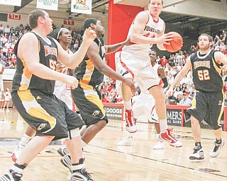 Vytas Sulskis (44) grabs a rebound during a game against Milwaukee on Jan. 24. Sulskis is one of just three returning players for the Youngstown State men's basketball team this season.