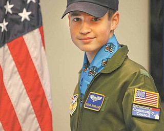 "Joshua Rowland, 14, of Canfield, was sworn-in Wednesday as an honorary Air Force Reserve 2nd Lieutenant and ""Pilot for a Day."" Rowland, a Canfield High School freshman, was diagnosed with Hodgkin's lymphoma two years ago, but has been cancer free for about a year."