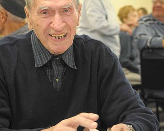 John Serenko of Austintown plays cards at the new Austintown Senior Citizen Center at 100 Westchester Drive.