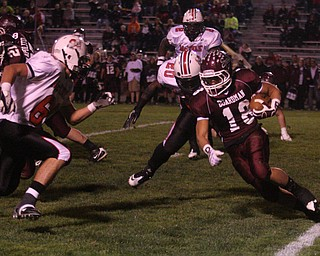 FOOTBALL - (18) Nick Buonavolonta tries to get yards as (68) Mike Aylward comes up for the tackle during their game Thursday night. - Special to The Vindicator/Nick Mays