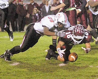FOOTBALL - (18) Nick Buonavolonta recovers his fumble as (29) Johnny Duncan tries to get in on the play during their game Thursday night. - Special to The Vindicator/Nick Mays