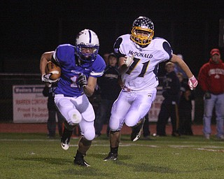 FOOTBALL - (1) Ryley Sheptock of Western Reserve tries to out run (71) Will Robison Friday night in Berlin Center. - Special to The Vindicator/Nick Mays