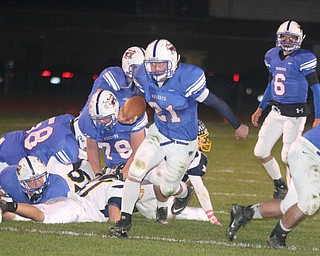 FOOTBALL - (21) Ed Newhouse of Western Reserve looks for running room Friday night in Berlin Center. - Special to The Vindicator/Nick Mays