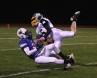 FOOTBALL - (3) Tim Cooper of Western Reserve picks off a pass intended for (15) Miles Dunlap Friday night in Berlin Center. - Special to The Vindicator/Nick Mays