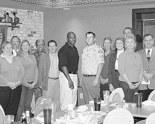Among those participating in a program during which proceeds from fundraising activities were distributed by the Warren Kiwanis Club were, from left, back row, Chrissy Brown of Summer Enrichment; Tim Schnaffner and Jo Carol Shaw-Franklin of Valley Counseling; Debbie Meeker of Camelot Center; Karen Mitchell of Trumbull County 4-H; Howard Agueda, president of the Kiwanis Club; and Bob Foster of Children's Rehabilitation Center, and in front, Ellen Finan of First Book-Trumbull County; Wendy Marvin of Warren YMCA; Dom Mancini of Children's Rehabilitation Center; Deryk Toles of Inspiring Minds; Patrick McFall of Greater Western Reserve Council Boy Scouts of America; and Shirley Walters of Trumbull County 4-H.