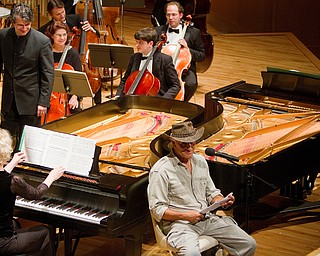 Geoffrey Hauschild|The Vindicator.Jack Hanna performs animal themed readings with musical accompaniment the Youngstown Symphony at the DeYor performing Arts Center on Sunday afternoon.
