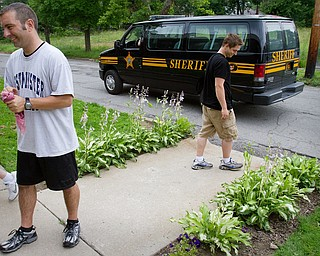 Geoffrey Hauschild|The Vindicator.6.15.2010.Portage County Sheriff's Deputy Mike Bussinger drives away from Ohio Valley Teen Challenge after asking residents Scott Fabry and John Wilden of the whereabouts of a dropout. OVTC notified the police after a dropout, who was at the center in lieu of correctional time, returned to the center seeking a refund on their deposit.