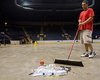 Geoffrey Hauschild|The Vindicator.6.26.2010.OVTC resident Jesse Repko works with a work crew from OVTC to clean up the Covelli Centre after a wrestling event.