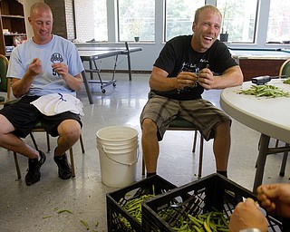 Geoffrey Hauschild|The Vindicator.8.5.2010.OVTC student, Ian Zimomra, and intern, Greg Todd, help pick beans in the cafeteria of the OVTC center. The beans are part of a donation to the center from a local farmer who hires the men to work and donates food during the warmer months.