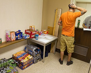 Geoffrey Hauschild|The VIndicator.8.5.2010.OVTC resident Justin Hensley buys pop and snacks from intern Sean Wilson, who works at the center's store which is open once a week for a short period of time.