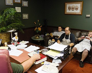 Geoffrey Hauschild|The VIndicator.8.5.2010.OVTC residents Brian Druschel, Steve Petracci and Kyle Ulner sit in the office of chef Al Franco while working on an upcoming catering project.