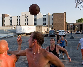 Geoffrey Hauschild|The Vindicator.8.6.2010.OVTC residents Ian Zimomra, Darren Vath, Sean Watkins, John Walsh and Josh Pasture play basketball in the center's parking lot during evening free time.