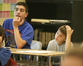ROBERT K. YOSAY | THE VINDICATOR..Watching an interactive Reading of  the raven is Ninth grader  Jeremy Seka and 4th grader Tibius (ok)  Kegley --Ninth graders at Jackson  Milton High School taught  fourth graders an interactive poetry lesson during a reading of The Raven by Edgar Allan Poe....  --30-..