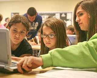 ROBERT K. YOSAY | THE VINDICATOR..teaching how to spot different parts of a poem is  Madison Tomaino 9  ( green) with Marissa Jonesco ( left  and Rose Pallota (glasses) both 4th graders - using students to help students gives more interactive time and both learn from the experience - Ninth graders at Jackson  Milton High School taught  fourth graders an interactive poetry lesson during a reading of The Raven by Edgar Allan Poe....  --30-..