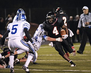 Canfield's Blake Jackson looks for an opening against Poland during their game at Canfield on Friday. Photo/Mark Stahl