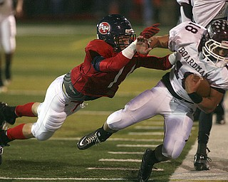 ROBERT  K.  YOSAY  | THE VINDICATOR --..Fitch's #11  Shane Stevens  pushes Bdm's #18  Nick Buonavolonta out of bounds after almost a first down for bdm. during first quarter action.Boardman battled  Fitch at Fitch Stadium Friday Night as the Regular season drew to a close -.... -30-(AP Photo/The Vindicator, Robert K. Yosay)