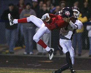 ROBERT  K.  YOSAY  | THE VINDICATOR --..Second time turns out wrong.. as BDM tried the same play twice  to score -   Fitch's #3 Cameron Paterson jumps higher and pulls in the interception from Bdm #1 Dyane Hammond... this stopped a bdm drive .. .Boardman battled  Fitch at Fitch Stadium Friday Night as the Regular season drew to a close -.... -30-(AP Photo/The Vindicator, Robert K. Yosay)
