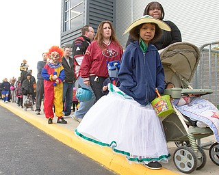 Geoffrey Hauschild|The Vindicator                           .Selina Castillo, 6, dresses as a southern belle in line to trick or treat at Covelli Centre on Saturday afternoon.