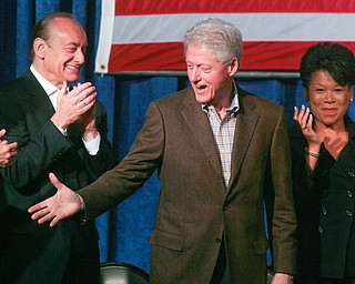 ROBERT  K.  YOSAY  | THE VINDICATOR --..President Bill Clinton shakes hands with party hopefuls as he entered - Sherrod Brown Lee fisher and Yvette McGee Brown .Former President Bill Clinton visited the Mahoning County Democrats annual breakfast Saturday morning in Youngstown..The former president was stumping for democratic hopefuls in state and congressional races here in Ohio .... -30-(AP Photo/The Vindicator, Robert K. Yosay)