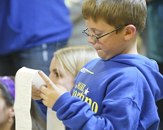 ROBERT  K.  YOSAY  | THE VINDICATOR --..Vincent Sciorintino ( mikes son ) reads a printout as his dad Mike took an early lead in The November election had many incumbents and levies pass.... -30-..(AP Photo/The Vindicator, Robert K. Yosay)