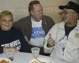 William D Lewis The Vindicator Tom Letson, chats with supporters Elanie and Grady Price of Warren during election night party at Enzo's in Warren Tuesday night.