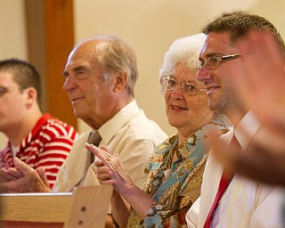 Geoffrey Hauschild|The Vindicator.6.25.2010.OVTC student, Jesse Repko, along with his grandparents and brother, applaud during a service honoring Jesse's graduation and the graduation of another student while at Youngstown Christian Assembly.